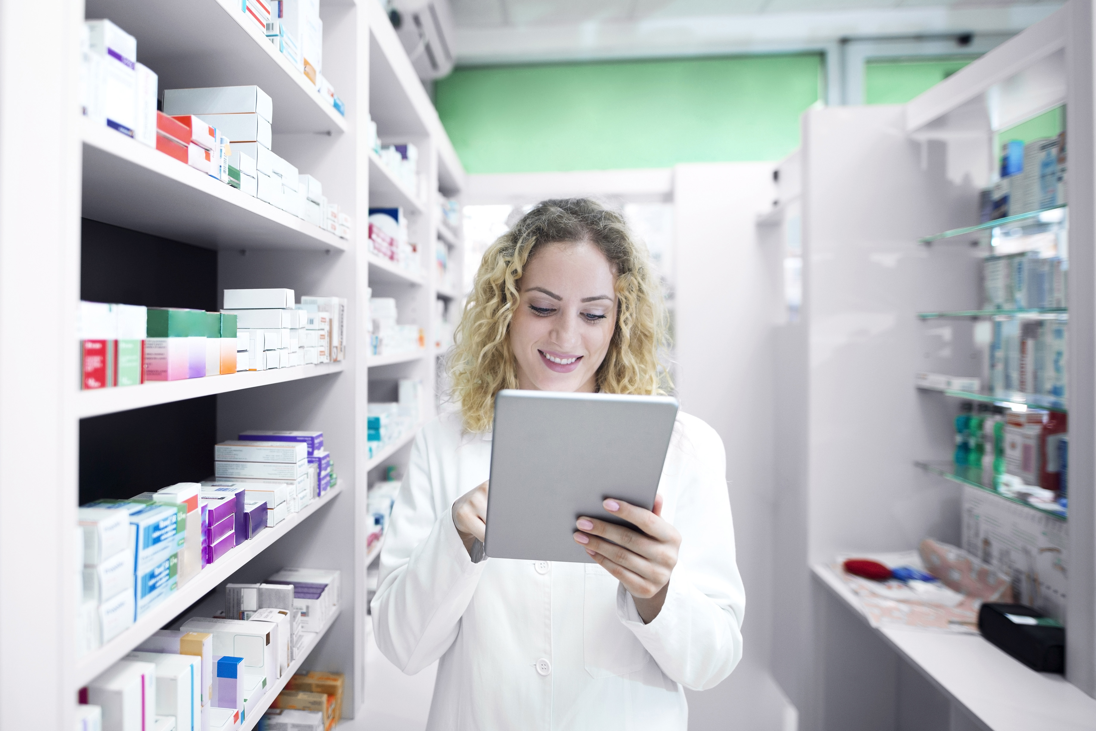 Pharmacist in a pharmacy doing inventory