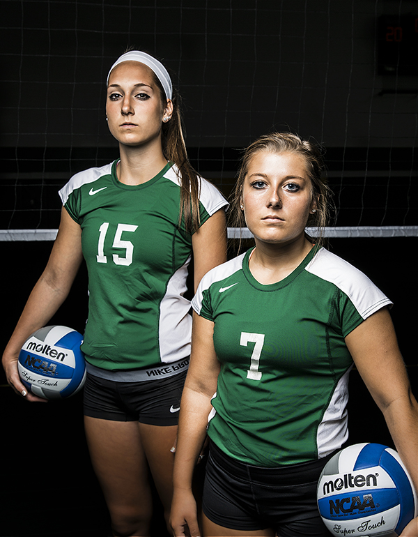 Women's Volleyball Team - two players posing by the net