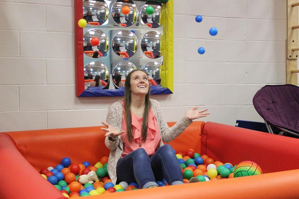 Martha Rinella '19 has a bit of fun in the ball pit inside the Division of Occupational Therapy's Pediatric Lab.