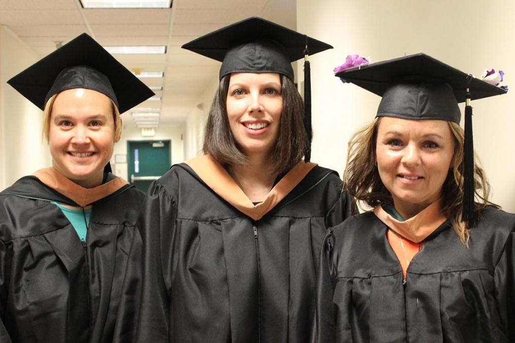 MSM grads, from left, Rena Terwilliger, Jenn Rivers, and Autumn Norman share a moment.