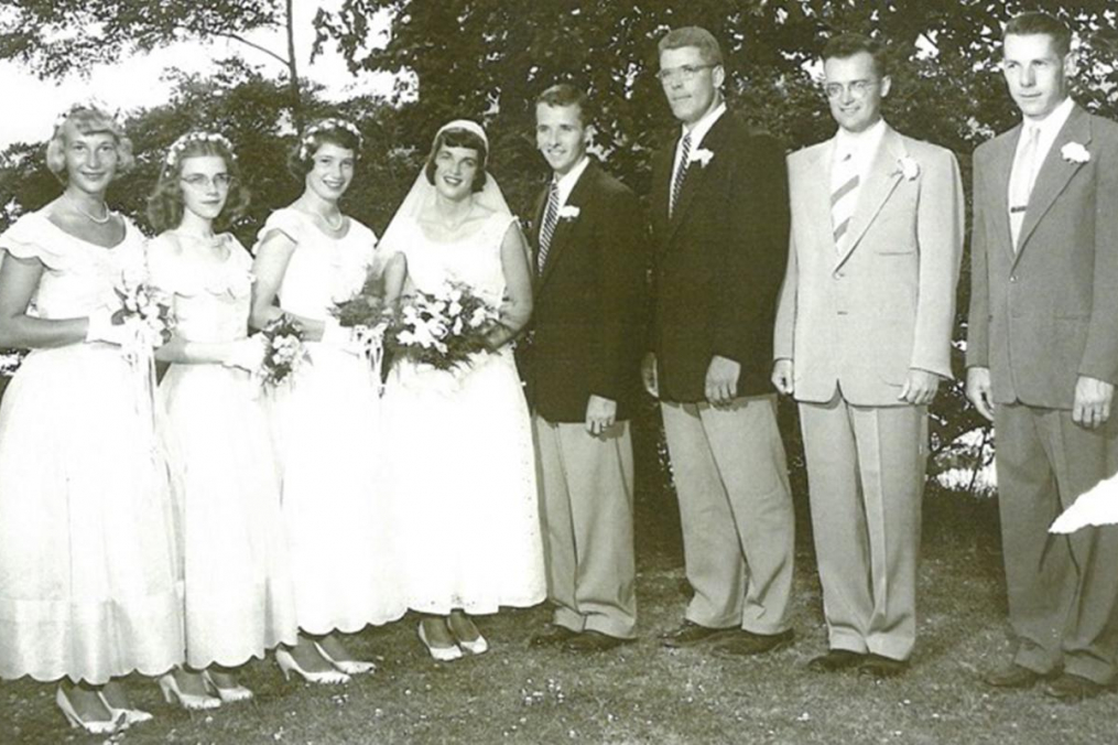 A wedding party in a black & white photograph
