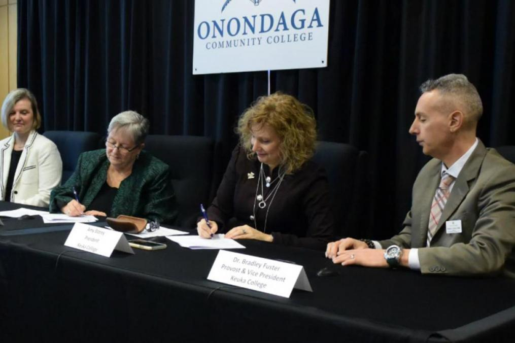 Officials from Keuka College and Onondaga Community College sign a partnership agreement for the BSW degree.