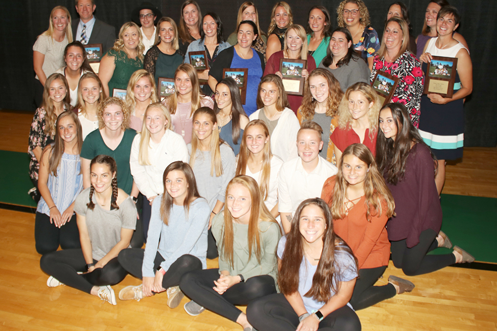The newly inducted 2001 Women's Soccer team poses with members of the current Women's Soccer team at the Dr. Arthur F. Kirk, Jr. Athletics Hall of Fame Induction & Dinner Friday night.