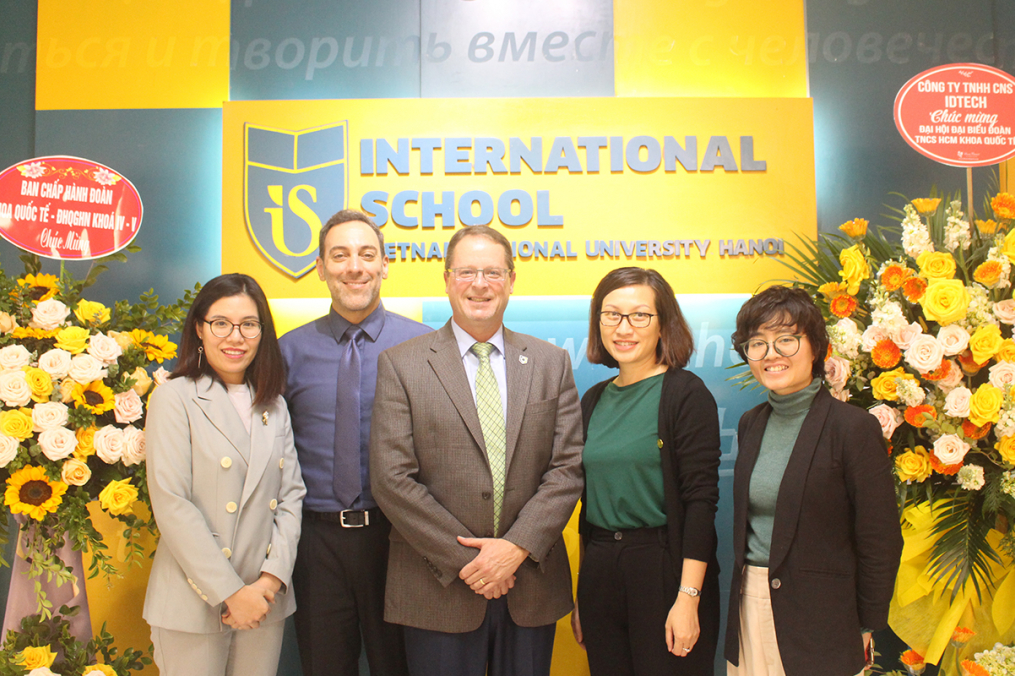 Keuka College's Dean of International Programs, Asia Gary Giss, second from left, and Vice President for Enrollment Management & Student Development Mark Petrie, center, poses with partners during a visit to Vietnam National University in Hanoi, Vietnam, in December. (Photo provided)