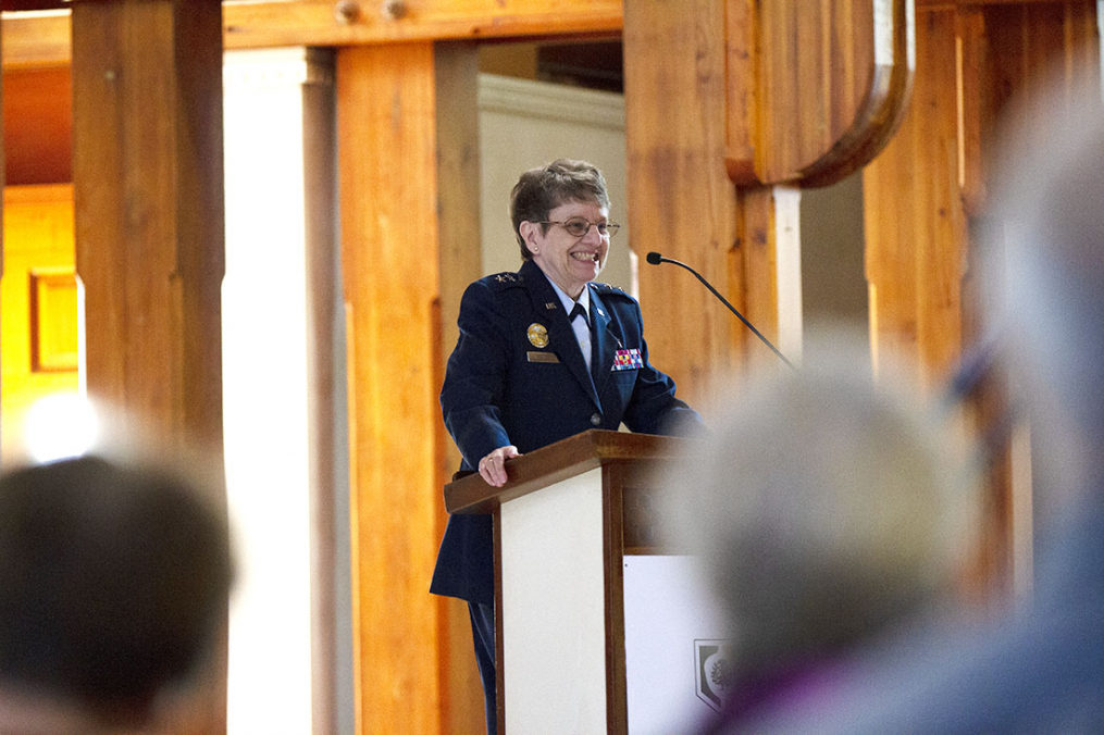 Maj. Gen. Lorraine K. Potter speaking at a podium in Norton Chapel