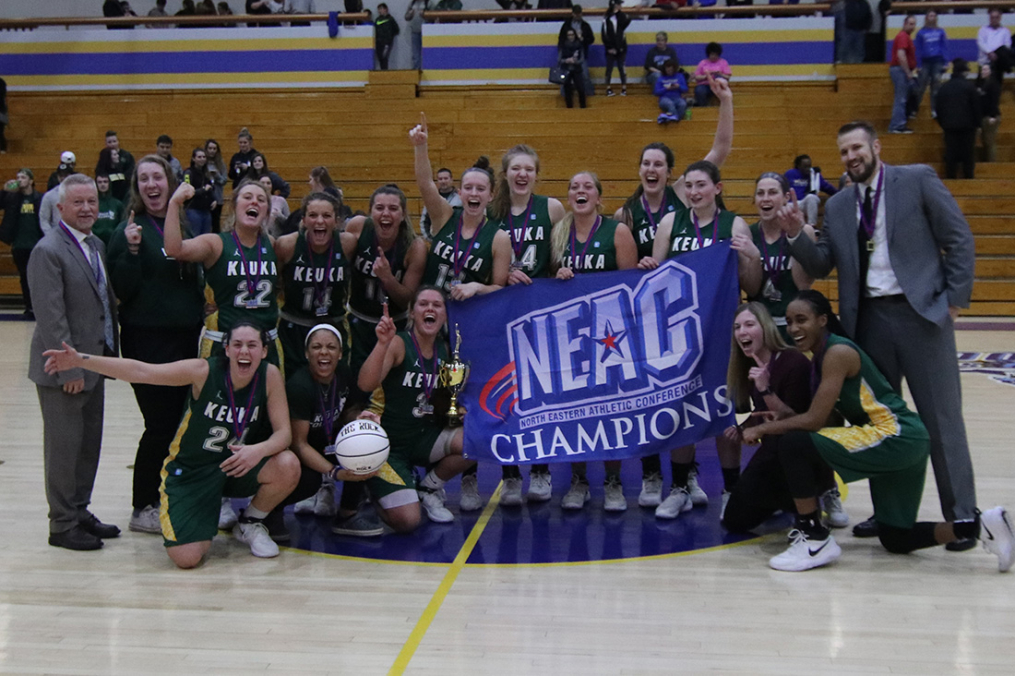 Women's Basketball team with NEAC banner