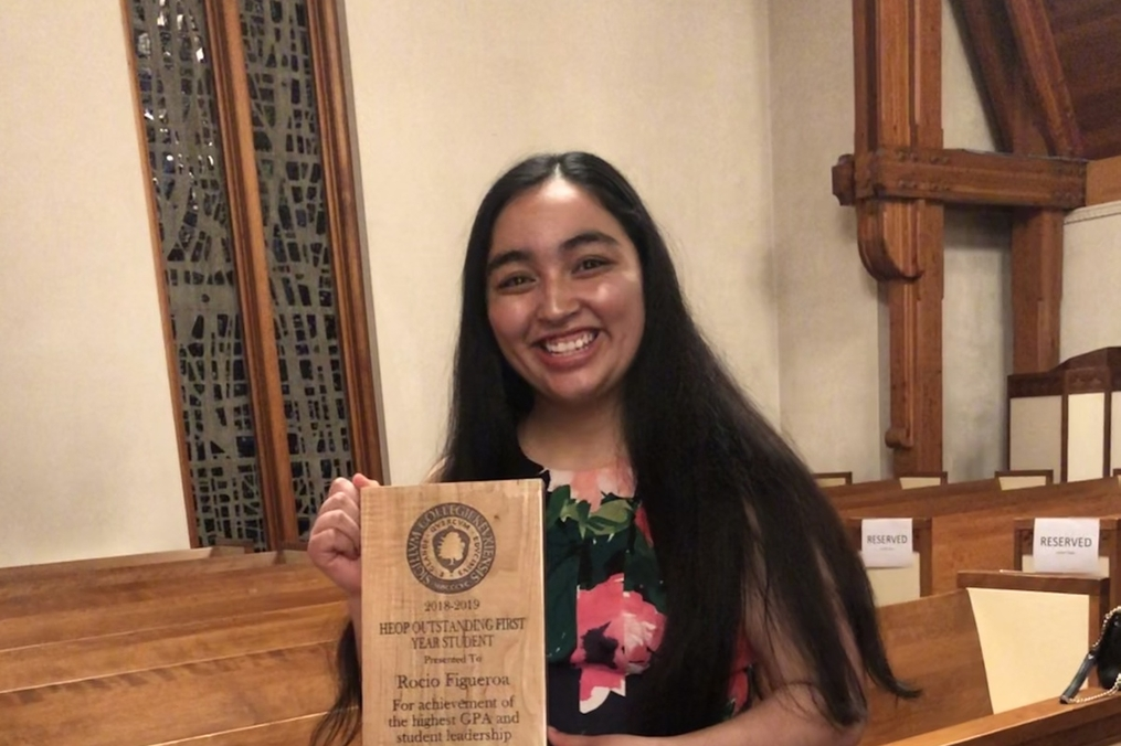 Rocio Figueroa '22 holding an award in the chapel