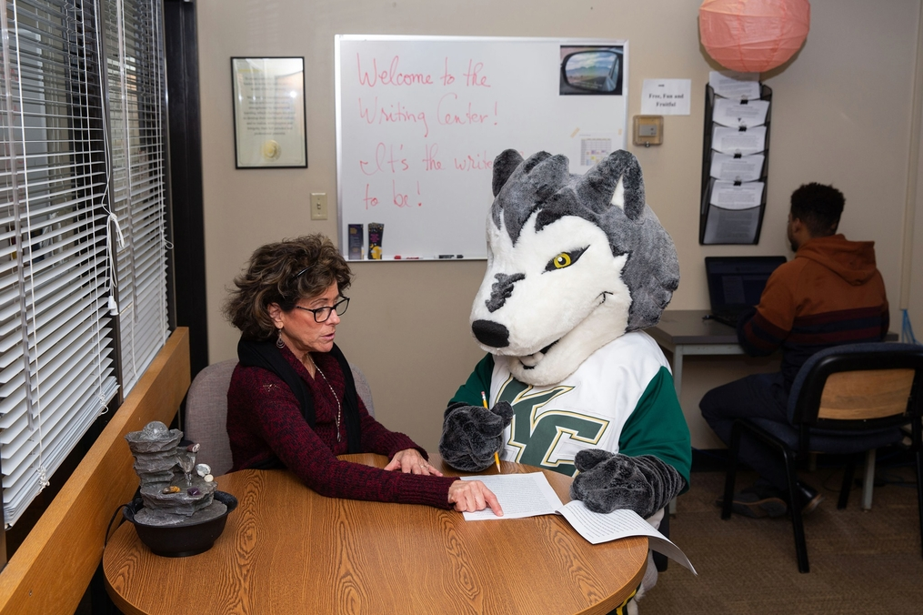 Kacey the Wolf gets writing advice from the Writing Center