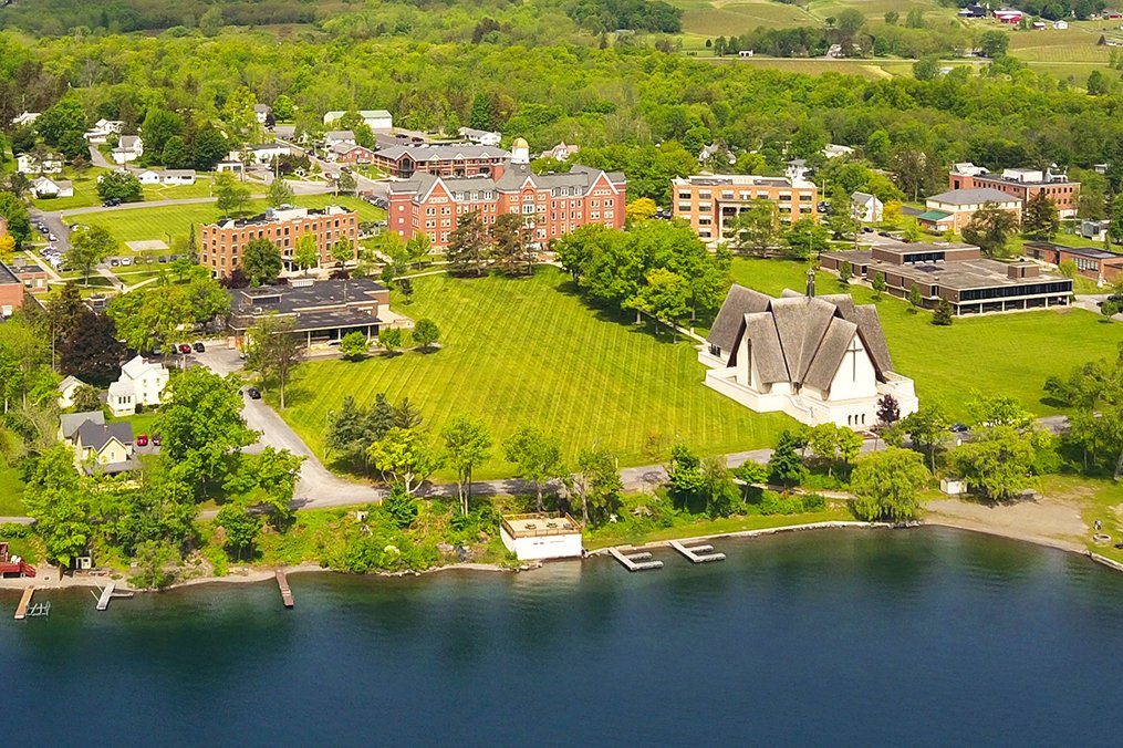 An aerial view of Keuka College's campus, showing a number of buildings and the lake