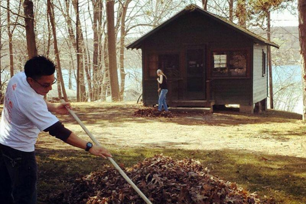 student raking leaves for the community