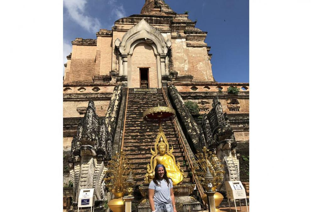 Sarah Honan '21 completed a summer Field Period® with Growth International Volunteer Excursions in Thailand. Here, she stands in front of the Wat Chedi Luang Buddhist Temple in the city of Chiang Mai, Thailand.
