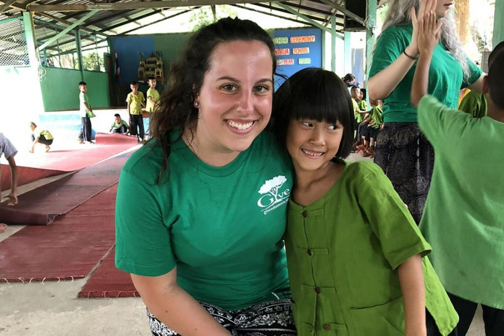 Sarah Honan '21 and one of the children she met during her summer Field Period® to Thailand.