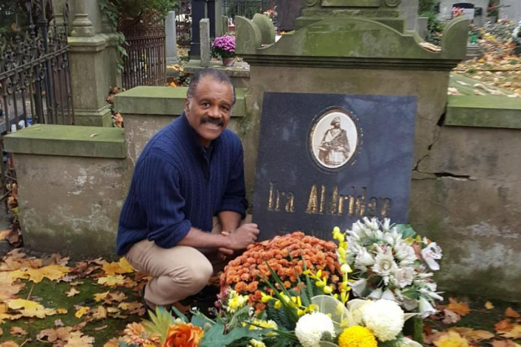 "Ira Aldridge's grave in Łódź, Poland. Visiting the grave is American actor Ted Lange, perhaps best known for his role as Isaac Washington on the TV series ""The Love Boat."" Lange always wanted to be a Shakespearean actor."