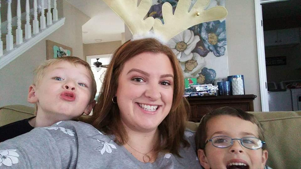 Alyssa takes a selfie with her two toddler newphews.