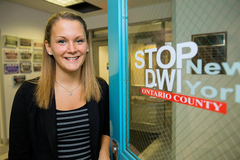 Brittany Heysler, a Criminal Justice degree graduate, outside of her internship with Ontario County.