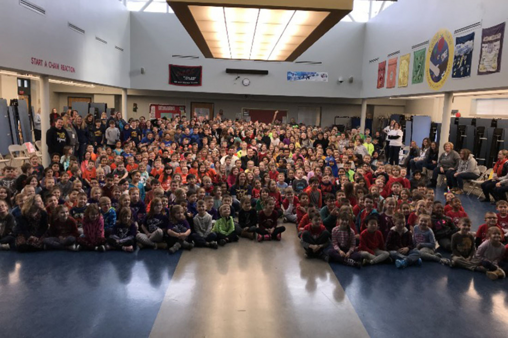 "Students at Canalview Elementary School in Spencerport, N.Y. listen as Joe Maier '16 M'17 and Dalton Letta share their story through a presentation titled ""No One Eats Lunch Alone."""