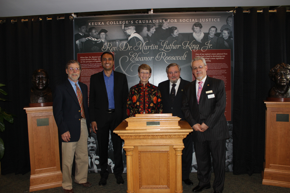Keuka College Professor Emeritus of Art Dr. Dexter Benedict, left, poses at the May 5, 2017, unveiling of two commemorative busts he created with, from left, Interfaith Youth Core founder and President Eboo Patel, Christine Wertman, Keuka College Trustee Donald Wertman, and Keuka College President Dr. Jorge Díaz-Herrera. The sculptures, of Rev. Dr. Martin Luther King, Jr., far left, and Eleanor Roosevelt, far right, were created by Dexter and commissioned by the Wertmans.