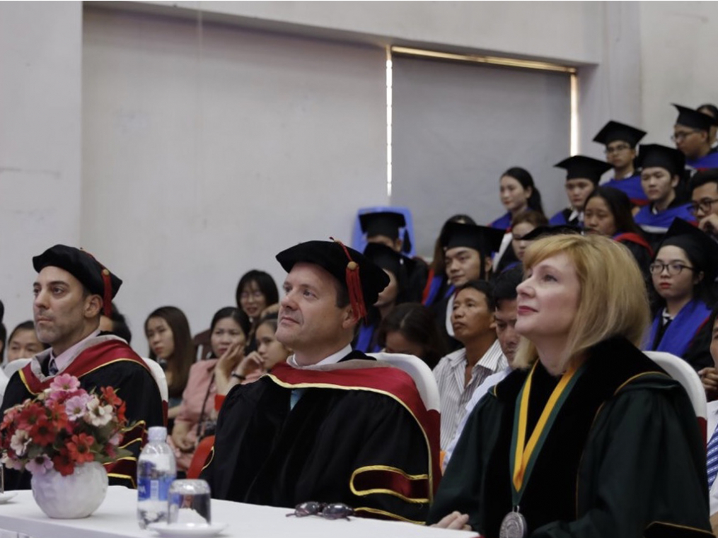 From left, Keuka College Dean of International Programs in Asia Gary Giss, Associate Provost Tim Sellers, and President Amy Storey attend Keuka College graduation ceremonies at Duy Tan University on June 9.