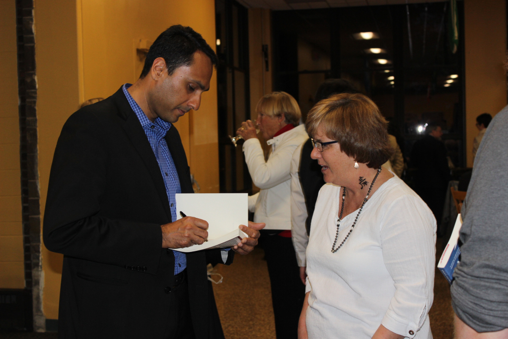 Eboo Patel, founder and president of Interfaith Youth Core, and the featured speaker at the 29th Annual Carl and Fanny Fribolin Lecture, speaks with Stephanie Craig at a reception following the lecture on May 5, 2017.