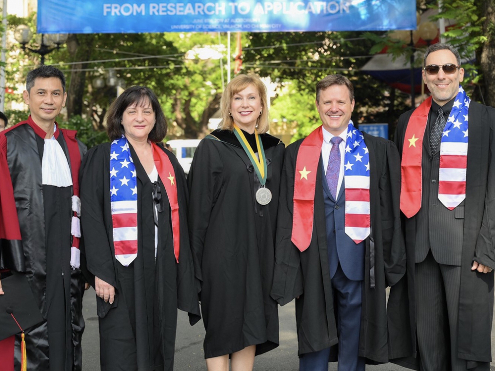 Keuka College President Amy Storey, center, attends graduation ceremonies at the Keuka College Vietnam Program at the University of Science in Ho Chi Minh City.