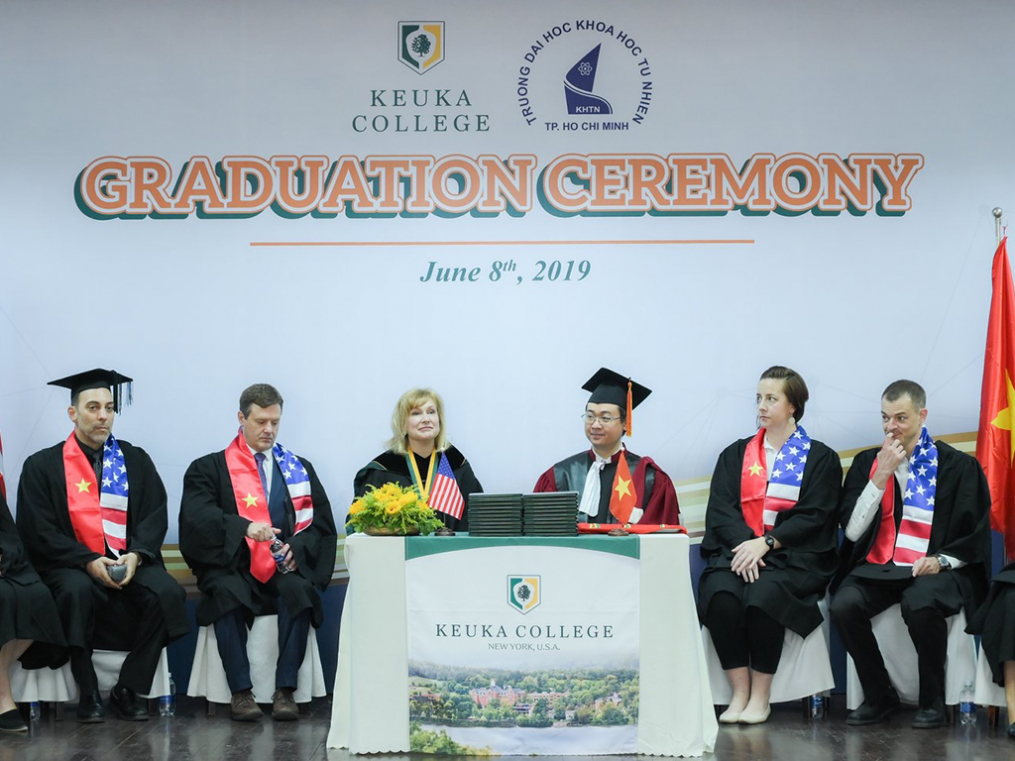 Keuka College President Amy Storey is joined at center stage by University of Science Dr. Tran Minh Triet during graduation ceremonies for the Keuka College Vietnam Program at the University of Science in Ho Chi Minh City.