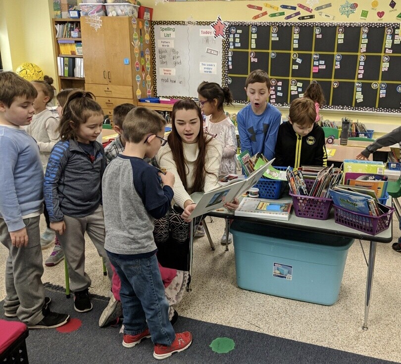 Student works with children in school during field period for keuka college