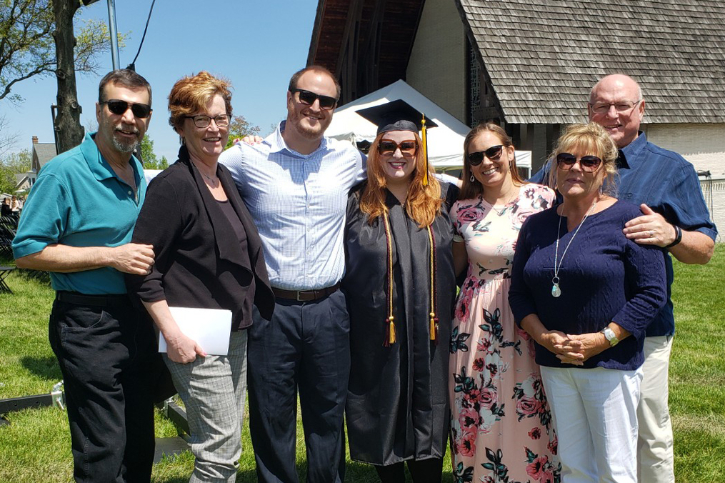 Alyssa Frederick stands with her family after graduation.