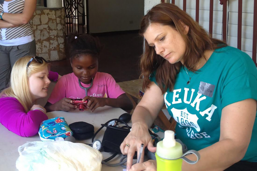 Keuka College nursing students work with a child in the Dominican Republic