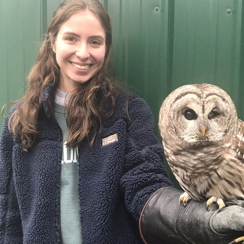 Grace Delrossa posing with an owl